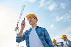 Builder in hardhat with walkie talkie Stock Images
