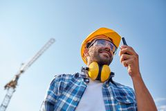 Builder in hardhat with walkie talkie Stock Photo