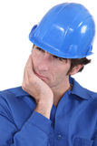 Builder having a good think Stock Photo