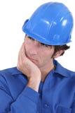 Builder having a good think Stock Photo