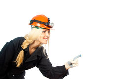 Builder in the helmet indicates a hand Stock Image