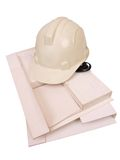 Builder Helmet Model. White colored Builder's Safety Helmet on top of architectural working Model royalty free stock image