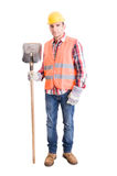 Builder with helmet, vest, gloves and shovel Royalty Free Stock Photos
