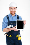 Builder holding blank screen tablet Royalty Free Stock Photography