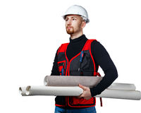 Builder holding blueprints and wallpaper Stock Photography