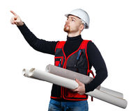 Builder holding blueprints and wallpaper Royalty Free Stock Photos