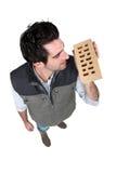 Builder holding brick Stock Photography