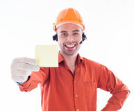 Builder holding a business card Royalty Free Stock Image