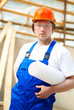 Builder holding construction plan Stock Photography