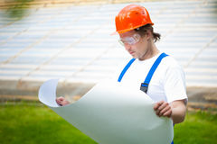 Builder holding construction plan Royalty Free Stock Image