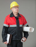 Builder holding documents and projects Stock Photos
