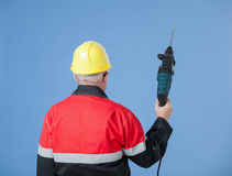 Builder holding a drill Royalty Free Stock Images
