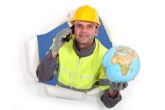 Builder holding globe Royalty Free Stock Image