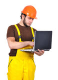 Builder holding laptop Royalty Free Stock Photos