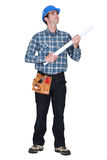 Builder holding plans Royalty Free Stock Image
