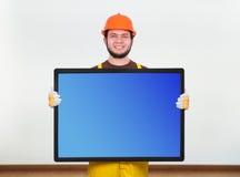Builder holding plasma Stock Photos