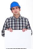 Builder holding poster Stock Images