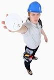 Builder holding smoke alarm Royalty Free Stock Images