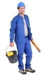 Builder holding spirit level. Stock Image