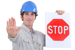 Builder holding stop sign Royalty Free Stock Photography