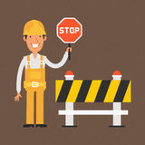 Builder holding stop sign and smiling Stock Photo