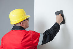 Builder holding a trowel Stock Photography