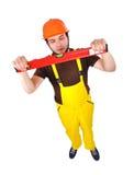 Builder holding wasserwaage Stock Photography