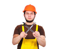 Builder holding wrench Royalty Free Stock Photos