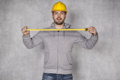 Builder holds a folding rule Royalty Free Stock Image