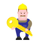 Builder holds a key Royalty Free Stock Images