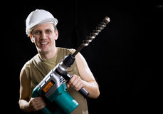 Builder  holds the professional puncher Stock Images