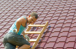 Builder injured his back while repairing the roof royalty free stock photos