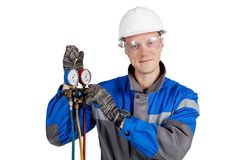 Builder, installer of ventilation with tools in hands stock photography