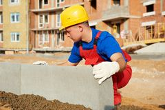 Builder installing road concrete kerb Royalty Free Stock Photos
