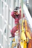 Builder joiner installing glass window on building Stock Photo