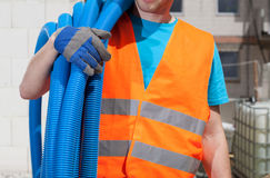 Builder keeping pipes Stock Images