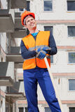 Builder keeping a spade Royalty Free Stock Image