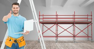 Builder with ladder and computer in font of 3D scaffolding Royalty Free Stock Image