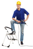 Builder with ladder and drill Royalty Free Stock Images