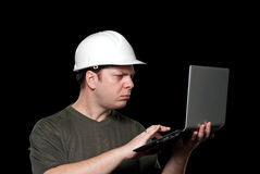 Builder with laptop Stock Photo