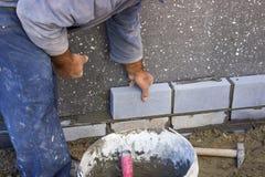 Builder laying bricks, constructing a wall Stock Photo