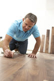 Builder Laying Wooden Flooring Stock Image