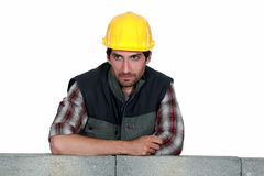 Builder leaning on wall stock photography