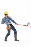 Builder lifting a house Stock Image