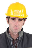 Builder looking upset Royalty Free Stock Photo