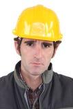 Builder looking upset Royalty Free Stock Photo
