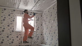 Builder makes the ceiling stock video