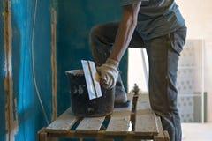 Builder makes repairs of walls Royalty Free Stock Image