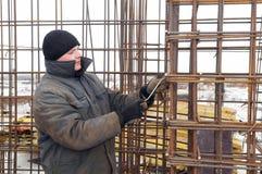 Builder making metal mesh Royalty Free Stock Images