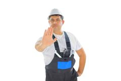 Builder making stop sign Royalty Free Stock Photo